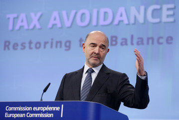 EU Economic and Financial Affairs Commissioner Moscovici gestures during a news conference on the tax avoidance package at the EU Commission's headquarters in Brussels