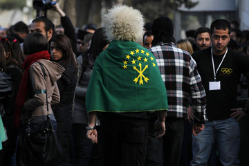 An ethnic Circassian wears a flag on his shoulders during a protest against the Sochi 2014 Winter Olympics in front of the Russian embassy in Amman