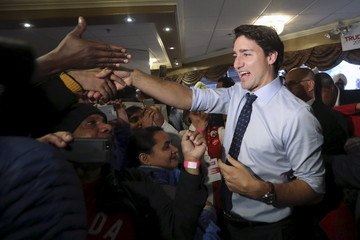 Trudeau greets supporters during a campaign rally in Edmonton