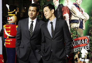 """Actors Kal Penn and John Cho pose at the premiere of the new film """"A Very Harold & Kumar 3D Christmas"""" in Hollywood"""
