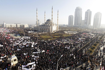 People attend a rally to protest against satirical cartoons of prophet Mohammad, in Grozny, Chechnya