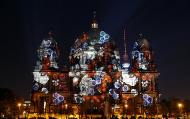 The Berlin cathedral is illuminated during the Festival of Lights in Berlin
