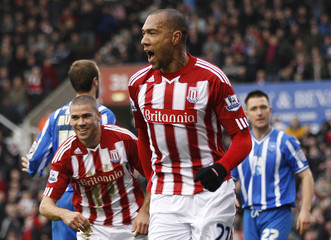 Stoke City's Carew celebrates his goal against Brighton and Hove Albion during their FA Cup soccer match in Stoke-on-Trent