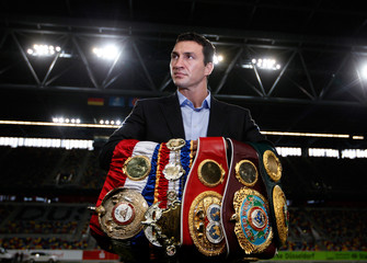 Heavyweight boxing title holder Klitschko of Ukraine poses during a news conference in Duesseldorf