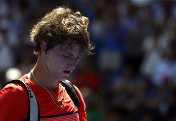 Germany's Zverev reacts as he walks off court after losing his first round match against Britain's Murray at the Australian Open tennis tournament at Melbourne Park, Australia