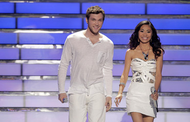 """Finalists Phillip Phillips and Jessica Sanchez stand on stage during the 11th season finale of """"American Idol"""" in Los Angeles"""