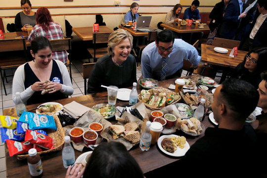 U.S. Democratic presidential nominee Hillary Clinton sits down for lunch with winners of an HFA contest at The Works Bakery Cafe in Durham
