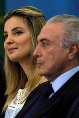 First lady Marcela Temer smiles near Brazil's President Michel Temer during a launch ceremony of the Happy Child Program at the Planalto Palace in Brasilia