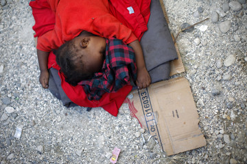 A young victim of Haiti's earthquake sleeps at a makeshift refugee camp in Port-au-Prince