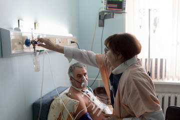 Nurse adjusting the level of oxygen