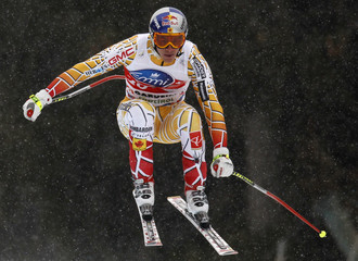 Guay of Canada goes airborne on his way to third place in the men's Super-g Alpine Skiing World Cup event on Saslong slope in Val Gardena