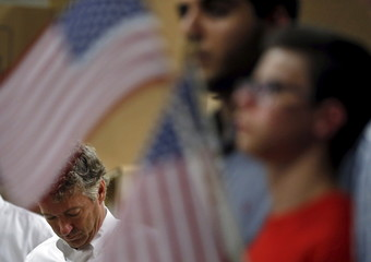 U.S. Republican presidential candidate Senator Rand Paul of Kentucky listens to his introduction during a campaign stop at Royal Kitchen and Bathroom Cabinets in Niles
