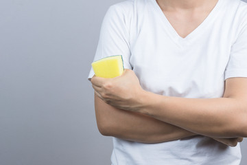Woman hand holding a cleaning sponge