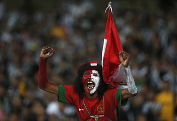 An ISL All-Stars supporter shout slogans during their friendly soccer match against Juventus in Jakarta