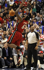 Heat forward James reacts after taking a foul from the 76ers during the fourth quarter of their NBA basketball game in Philadelphia