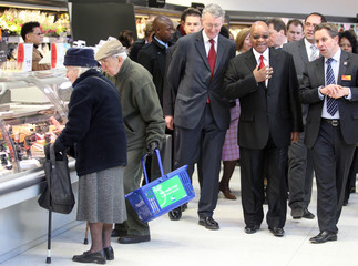 South African President Zuma, is accompanied by Environment Secretary, Benn and CEO of Sainsbury's, King, as they tour a branch of Sainsbury's in south London