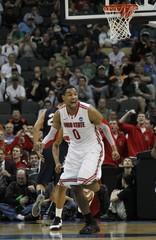 Ohio State University's Jared Sullinger celebrates his basket against Gonzaga University