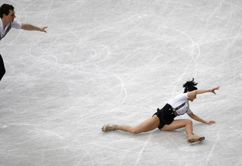 France's Popova falls as her partner Massot looks on during the pairs short program at the ISU World Figure Skating Championships in Saitama
