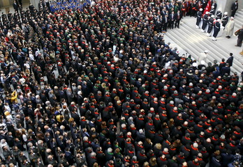People attend the funeral ceremony of prosecutor Mehmet Selim Kiraz at the Justice Palace in Istanbul