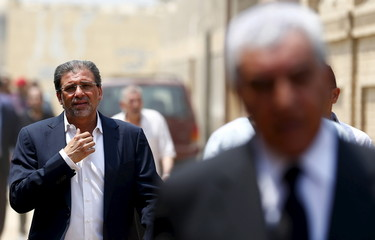 Egyptian director Khaled Youssef arrives for the burial ceremony of Egyptian actor Omar Sharif at El Shafie Cemetery in the old Islamic area of Cairo, Egypt