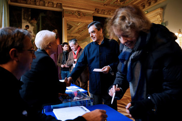 French politician Fillon, member of the conservative Les Republicains political party, casts his ballot during the second round of the French center-right presidential primary election in Paris