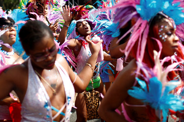 Participants dance during the West Indian Day Parade in the Brooklyn borough of New York