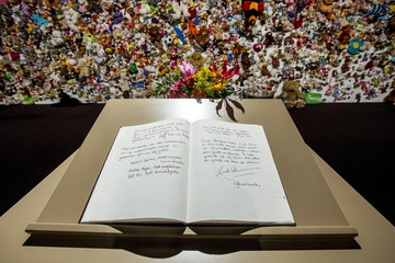A condolence register with a message of Dutch King Willem-Alexander and Queen Maxima lies in front of a hedge of compassion prior to a commemoration ceremony for the victims of Malaysia Airlines flight MH17 in Nieuwegein