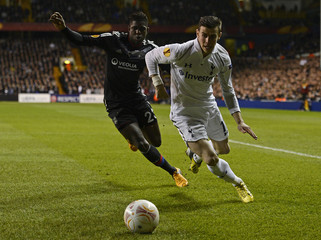 Gareth Bale of Tottenham Hotspur challenges Samuel Umtiti of Olympique Lyonnais during their Europa League soccer match in London