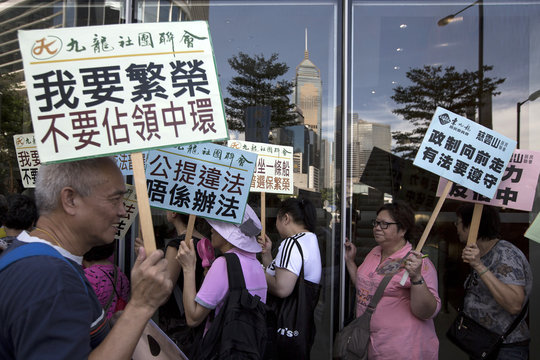 Pro-China supporters rally against the Occupy Central Movement and in support of the government's consultation report on methods for electing the Chief Executive in 2017, in Hong Kong