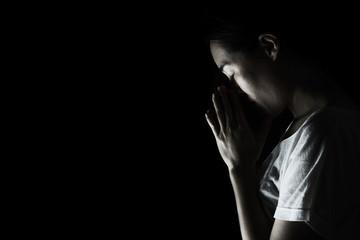 depress woman praying in the dark ( praying in secret room concept )