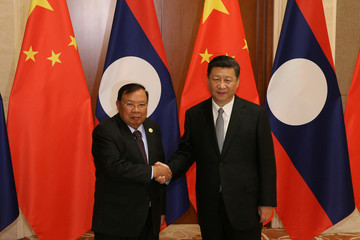 Laos President Bounnhang Vorachith and Chinese President Xi Jinping meet in Beijing
