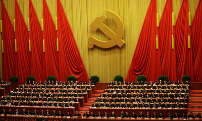 Delegates attend the closing session of the 18th National Congress of the Communist Party of China at the Great Hall of the People in Beijing