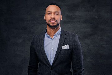 Studio portrait of elegant black male dressed in a suit.