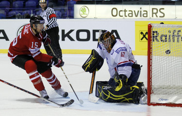 Zajac of Canada scores against France's goal keeper Lhenry during their preliminary round game at the Ice Hockey World Championships in Kosice