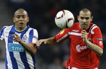 Porto's da Silva battles for the ball with CSKA Sofia's Stoyanov during their Europa League Group L soccer match at Dragao stadium in Porto