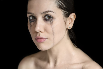 Studio portrait of wet woman