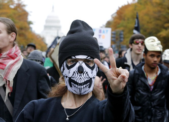 """Protesters demonstrate as part of global """"Million Mask March"""" protests in Washington"""
