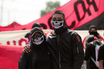 Demonstrators participate in the May Day march in San Salvador