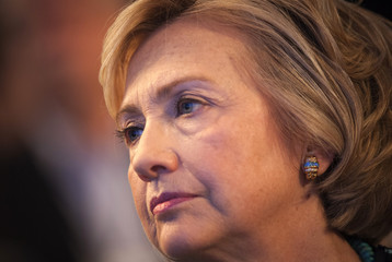 Former U.S. Secretary of State and former U.S. first lady Hillary Clinton sits and watches during the Clinton Global Initiative 2013 (CGI) in New York