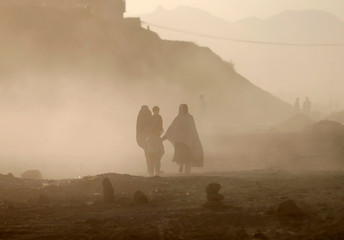 Afghan family heads home during a dust storm  in Kabul