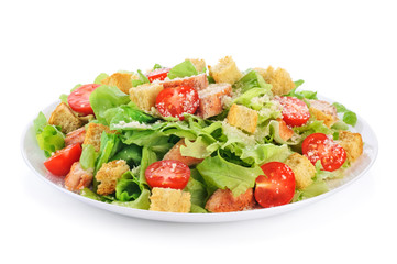 Caesar salad on white background.