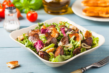 Warm salad with grilled chicken liver and toast