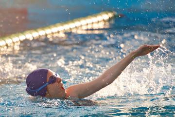 Woman swim in open pool