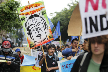 Demonstrators shout slogans against Peru's former president Fujimori during a protest in Lima