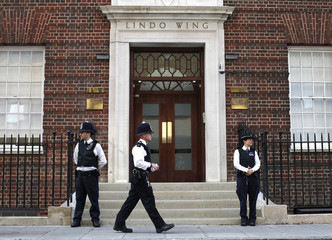 Police officers stand in front of the Lindo Wing of St Mary's Hospital, where Britain's Catherine, Duchess of Cambridge arrived to give birth in London