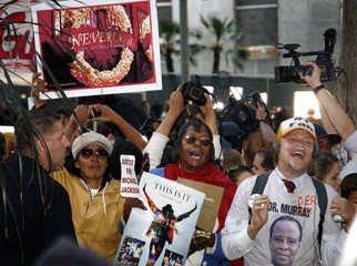 Fans of Michael Jackson react outside the courthouse after the reading of the guilty verdict in Dr. Conrad Murray's trial in Los Angeles