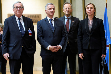 Swiss Foreign Minister Burkhalter welcomes EU High Representative for Foreign Affairs Mogherini and EU Commission President Juncker at the European headquarters of the United Nations in Geneva, Switzerland