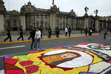 Flower carpet with the image of Santa Rosa de Lima (Saint Rose) is seen at the main plaza with Government Palace on the back during celebrations of Saint Rose of Lima