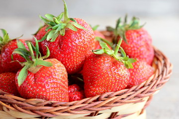 Fresh red strawberries. Sweet juicy strawberries in a wicker basket. Garden berries photo. Closeup