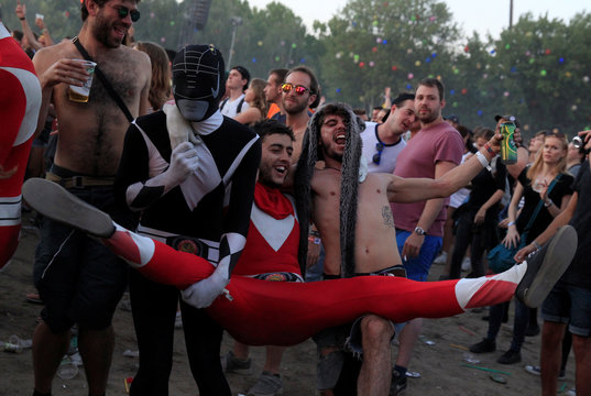 Festivalgoers attend a concert by the British singer Tinie Tempah during Sziget music festival on an island in the Danube River in Budapest